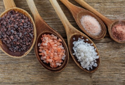 Variety of salts in wooden spoons