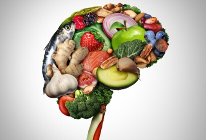 Healthy brain food to boost brainpower nutrition concept as a group of nutritious nuts fish vegetables and berries rich in omega-3 fatty acids for mind health as a composite image.