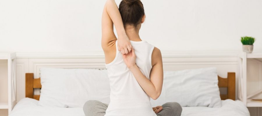 Morning yoga. Woman practicing yoga in Cow Face Pose
